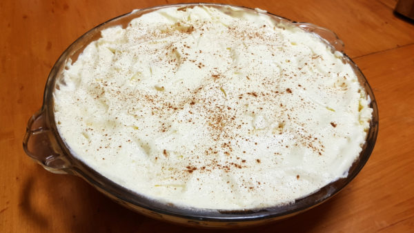 Banoffee Pie in it's final form with a dusting of cinnamon on top.